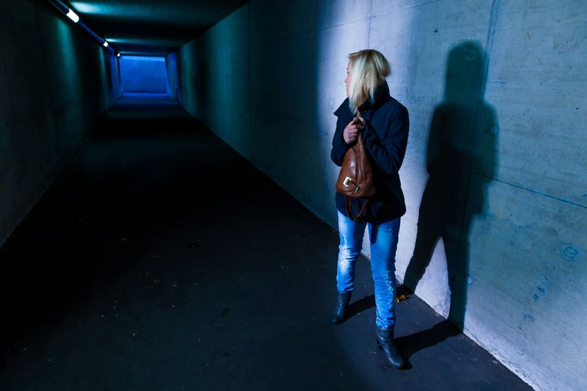 16392102 - a young woman in an underpass