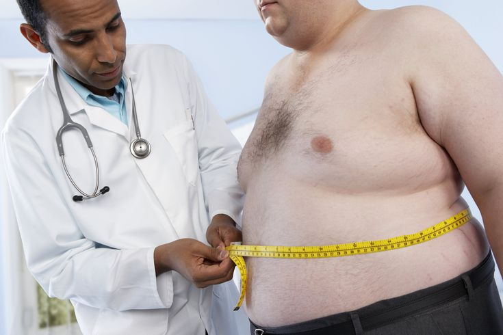general-practitioner-measuring-waist-of-obese-patient-91559789-599c65cd6f53ba00100f9e55